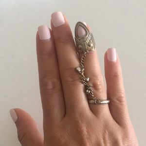Finger cage ring with chain detailing.